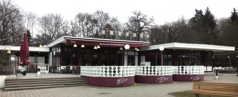 Berlin Friedrichshain: green park and red historic architectural monument