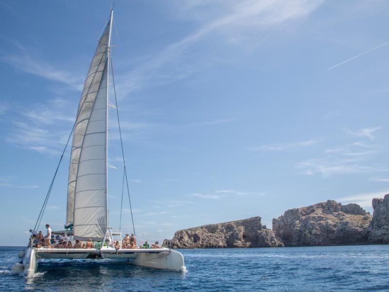Lazy sailing day aboard a catamaran in Cala Ratjada